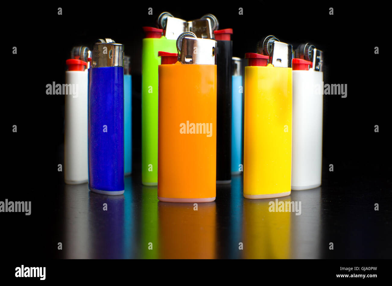 lighters colorful many black background smoking - Stock Image