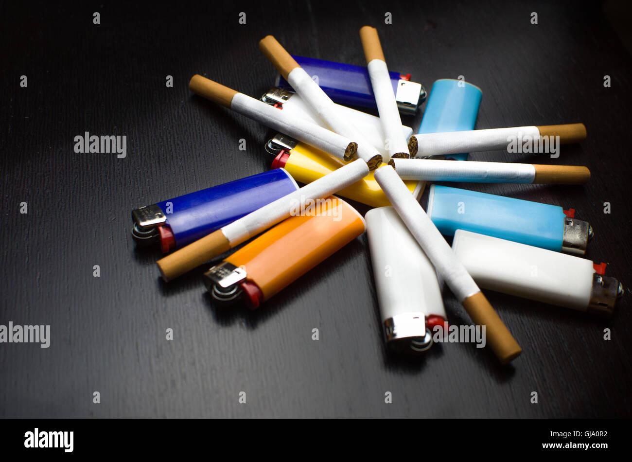 lighters and cigarettes black background elegant - Stock Image