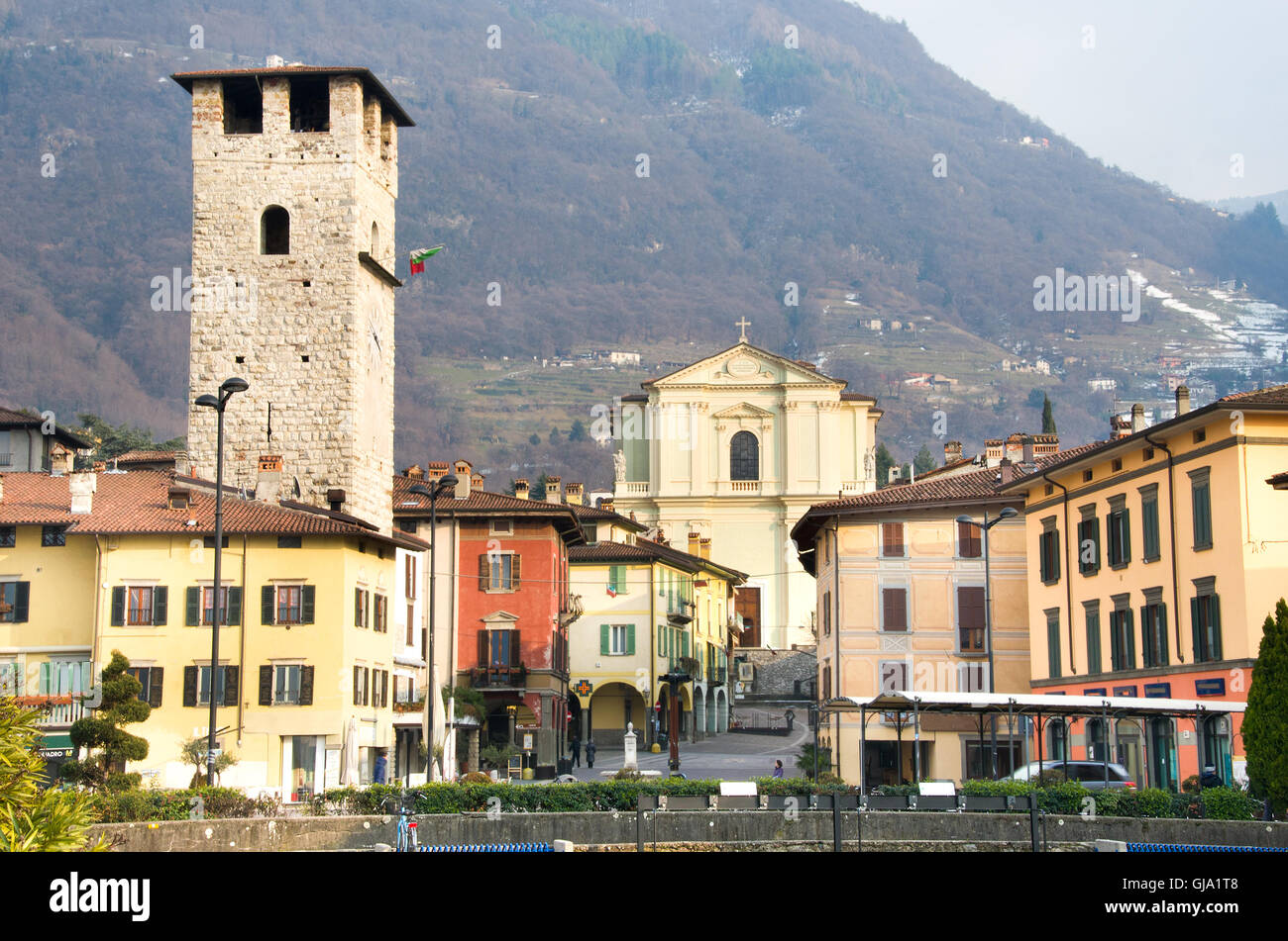 Brescia, Italy - February 16, 2013: the town center of Pisogne during winter, with the Vescovi tower and the Santa - Stock Image
