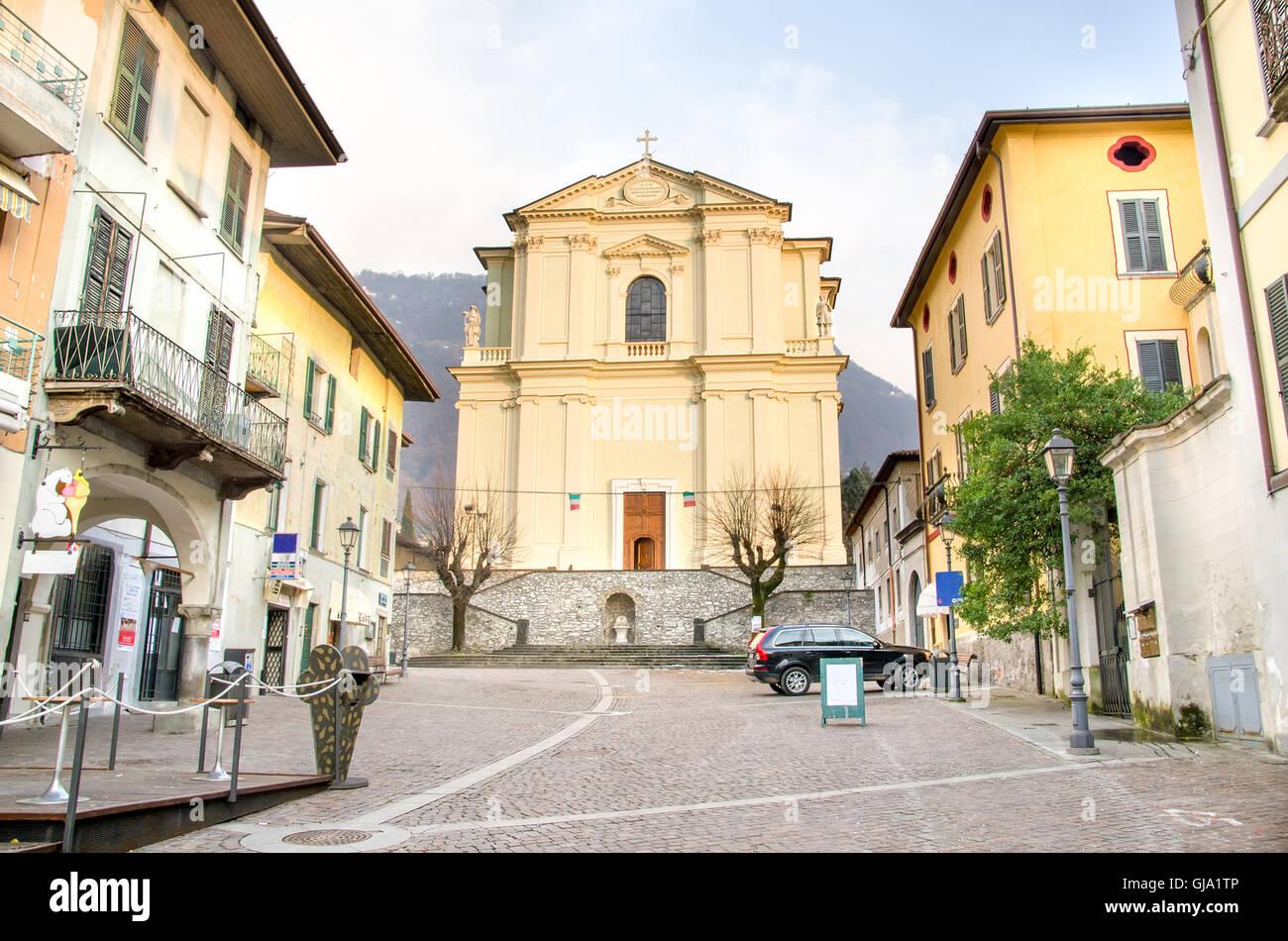 The Santa Maria church facade in the historic center of Pisogne - Stock Image