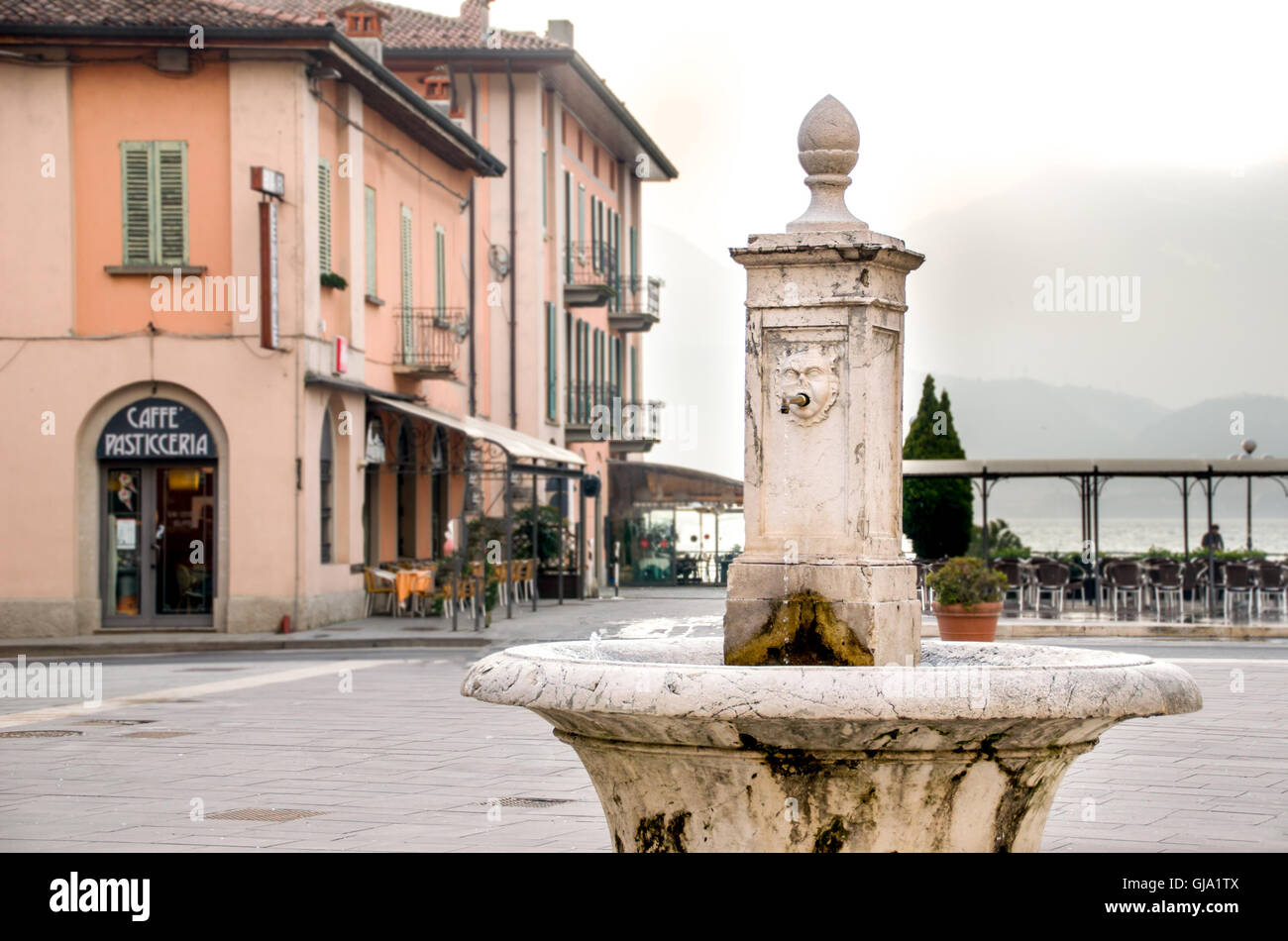 Pisogne, Italy - February 16, 2013: ancient fountain in the town center of Pisogne on the Iseo Lake shore - Stock Image