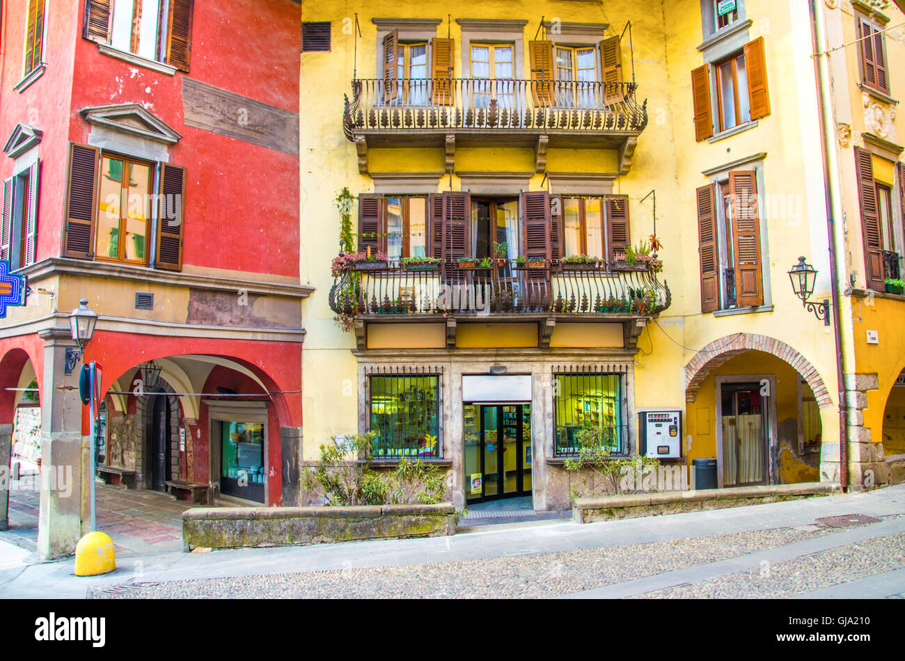 Pisogne Colorful and ancients houses and shops in the historic centre of the town on Iseo lake - Stock Image
