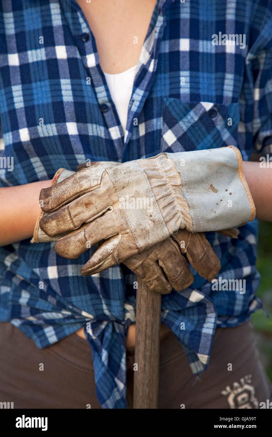 Gardening, garden gloves, shirt, shovel - Stock Image
