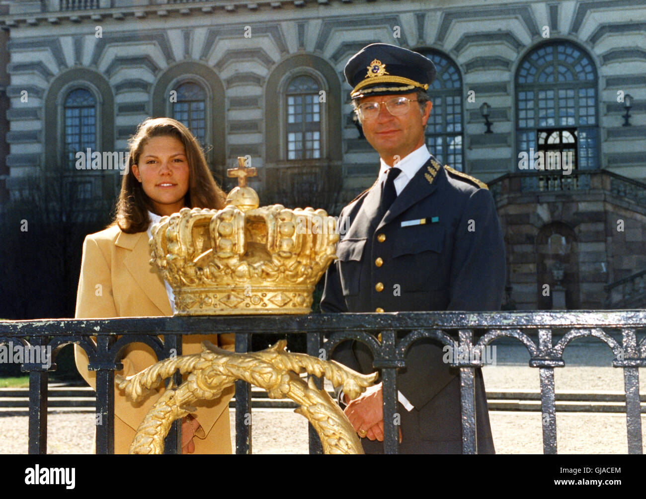 Swedish King CARL XVI GUSTAV and Crown Princess Victoria  beside a plated gold crown at Royal Palace at The Kings - Stock Image