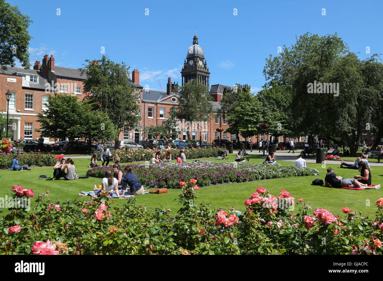 The view of Leeds Town Hall from Park Square in Leeds, West Yorkshire, on a hot sunny summers day. - Stock Image
