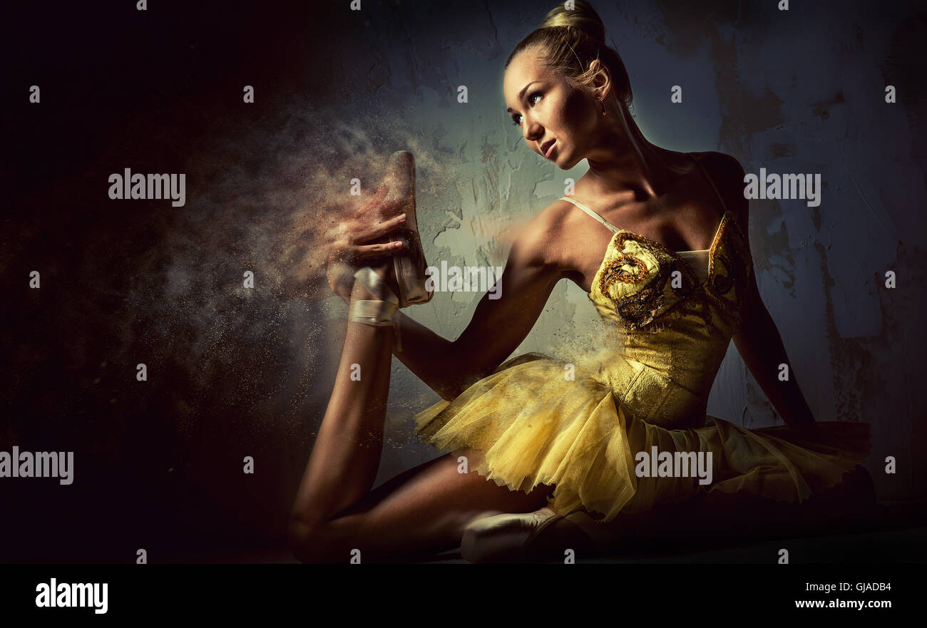Lovely ballerina in yellow tutu. Image with a digital effects - Stock Image