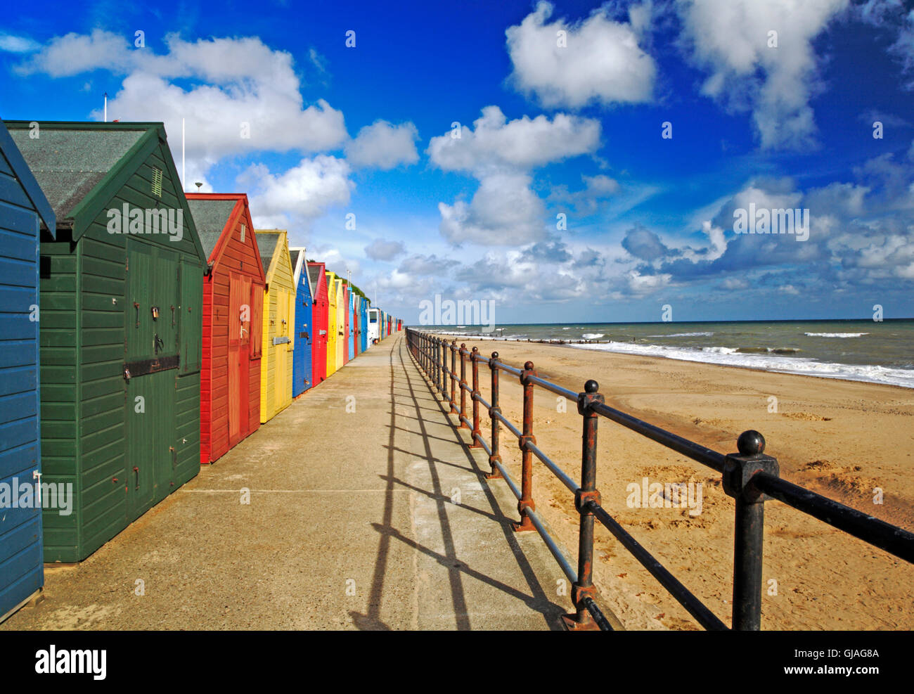 A view of the promenade and beach huts on the North Norfolk coast at Mundesley, Norfolk, England, United Kingdom. - Stock Image