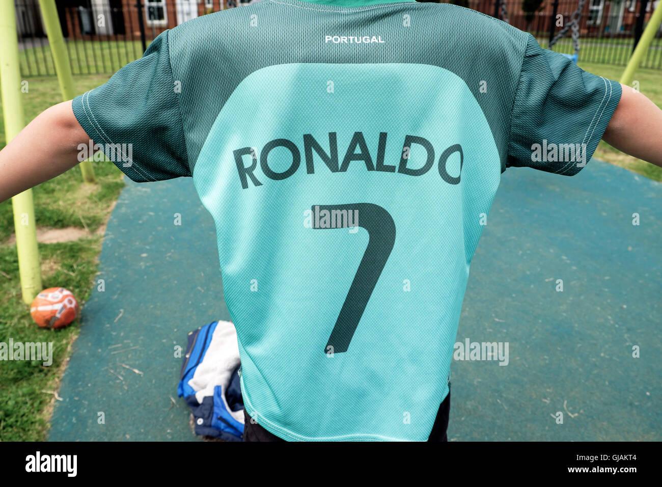 c628d93f0 Child fan wearing Cristiano Ronaldo 7 green Portugal Euro 2016 football  shirt in UK playground KATHY