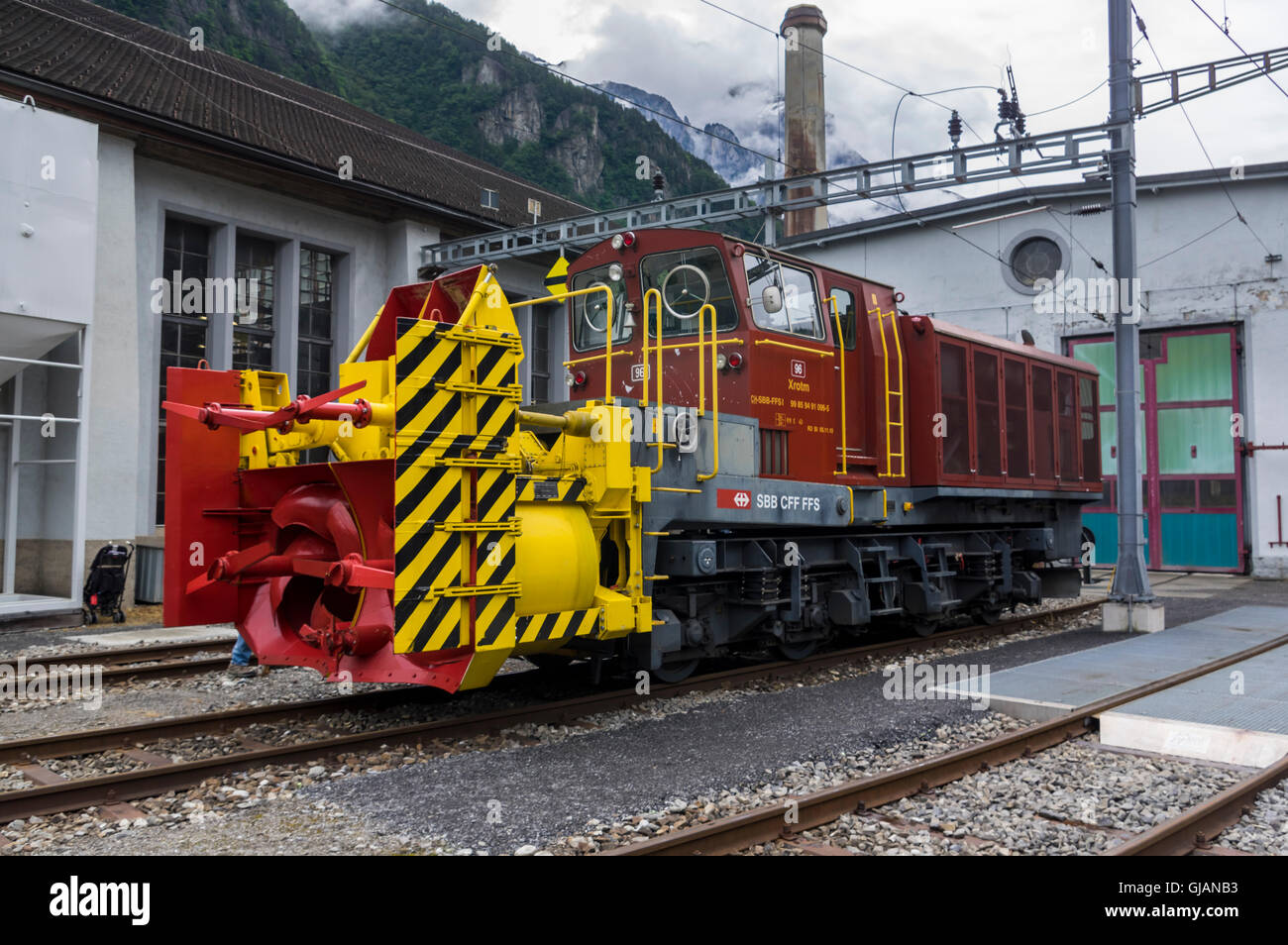 Diesel-hydraulic rotary snowplow Xrotm 96, built 1982 and operated by SBB, the Swiss Federal Railways. - Stock Image