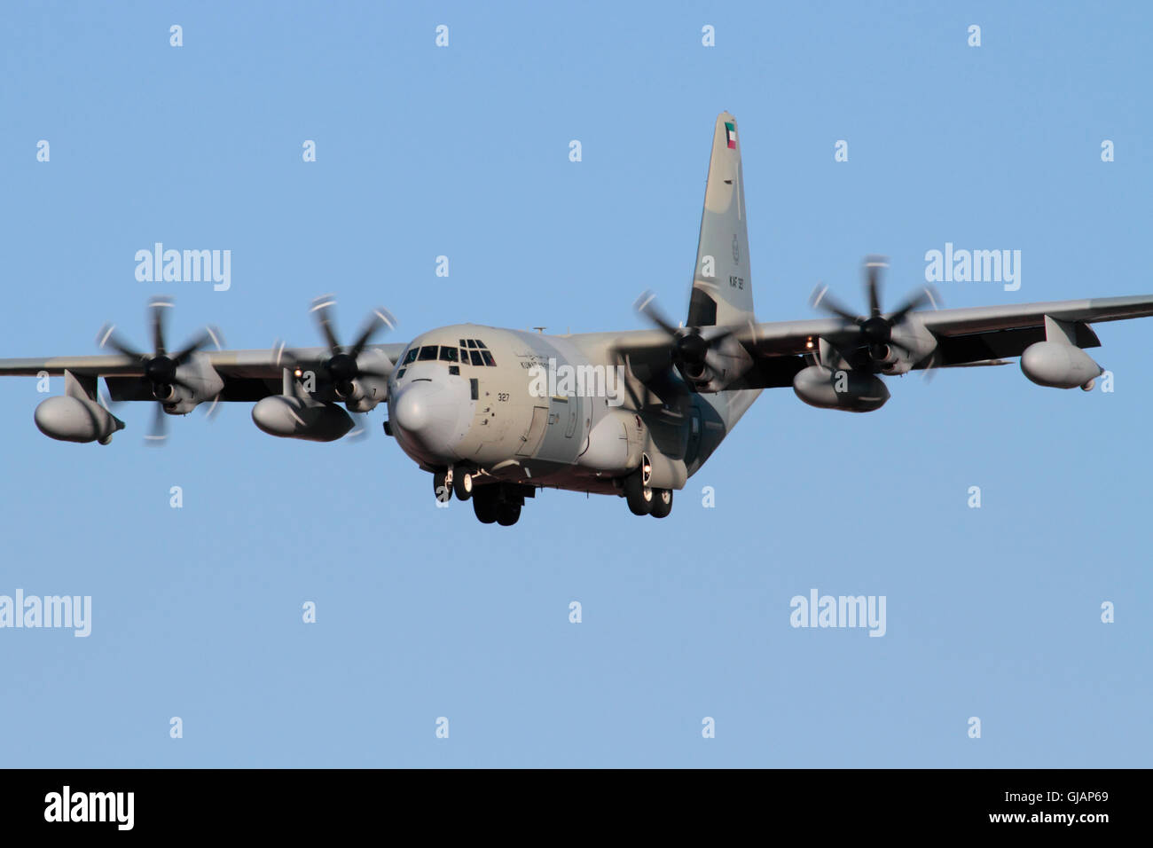 Lockheed Martin KC-130J Hercules four engine turboprop military transport plane of the Kuwait Air Force on approach - Stock Image