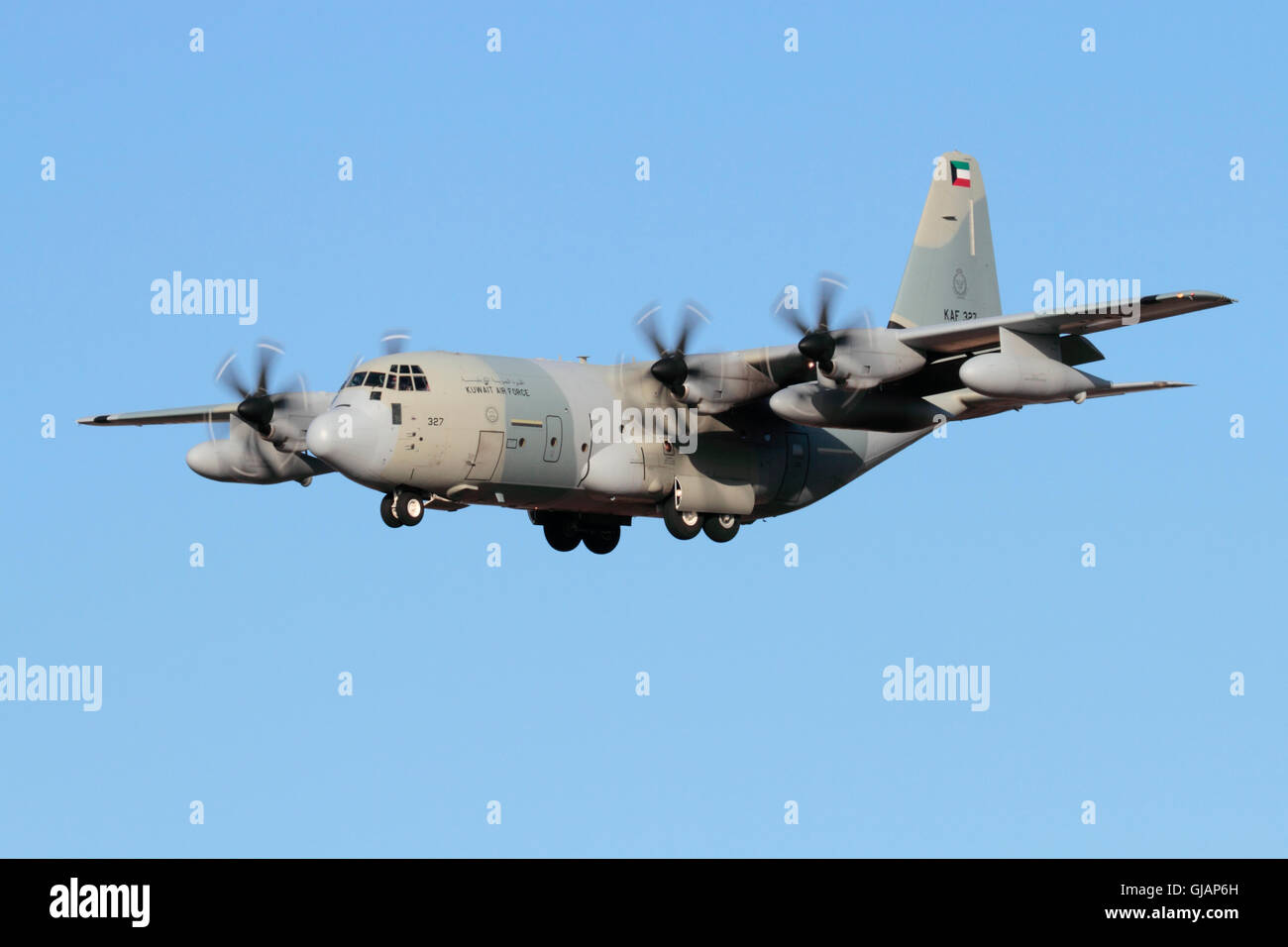 Kuwait Air Force Lockheed Martin KC-130J Hercules military transport airplane on approach - Stock Image
