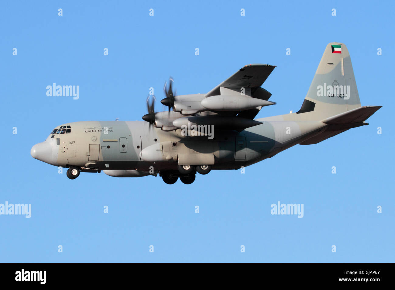 Lockheed Martin KC-130J Hercules of the Kuwait Air Force on approach against a clear blue sky - Stock Image