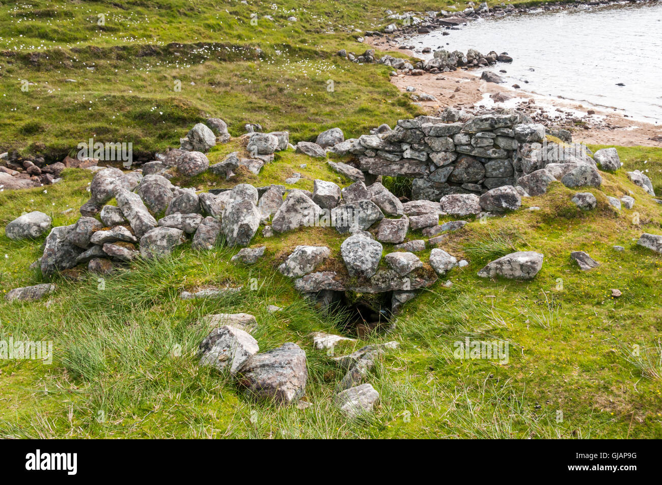 Remains of Norse style click mill at Loch Camasord near Crowlista in the Isle of Lewis. - Stock Image