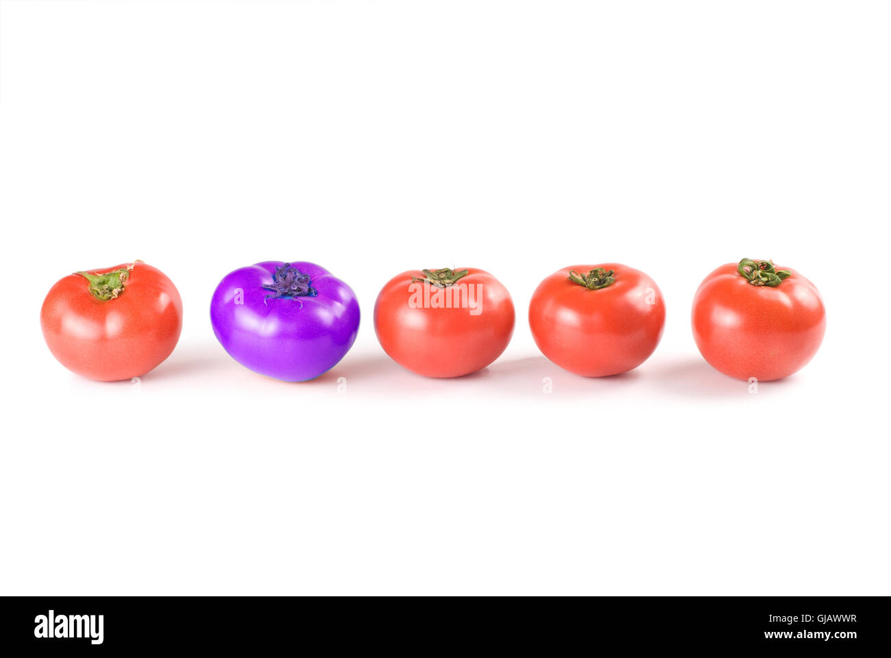 Different than the rest, tomatoes. - Stock Image