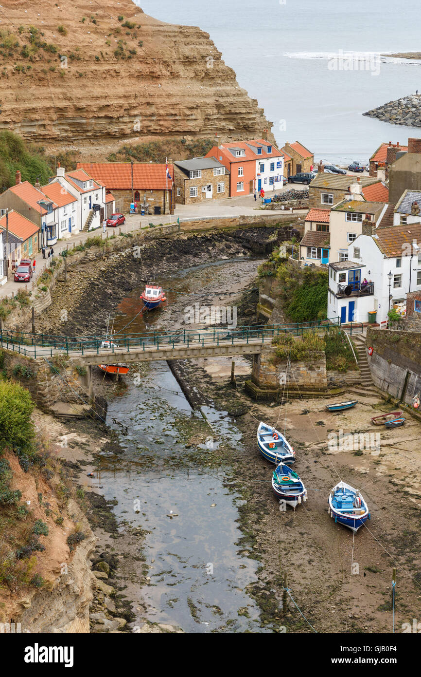 High view looking down onto Staithes Beck and the town. In Staithes, North Yorkshire, England. On - Stock Image