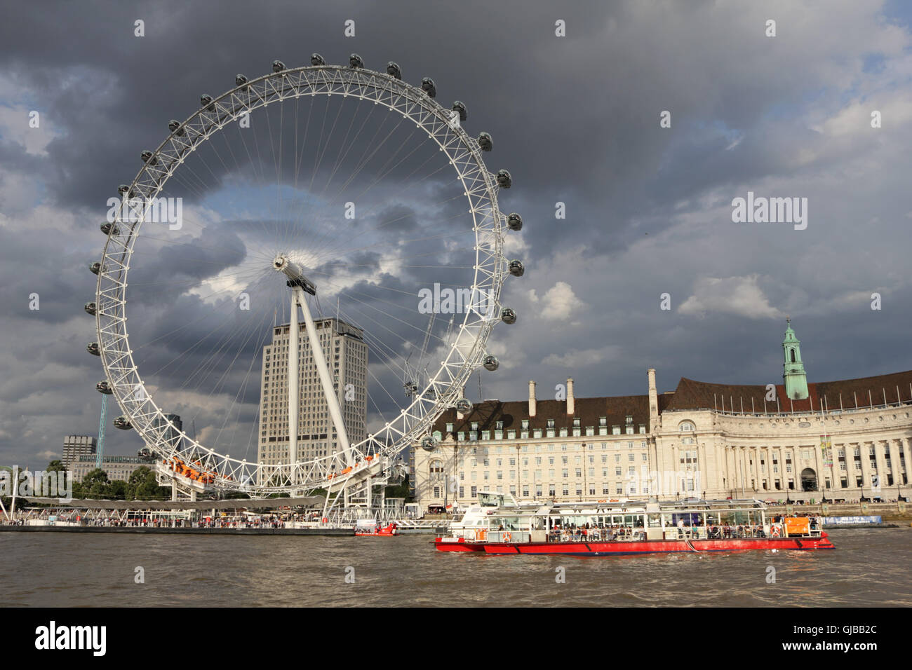 The London Eye beside County Hall on the Southbank London England UK Stock Photo