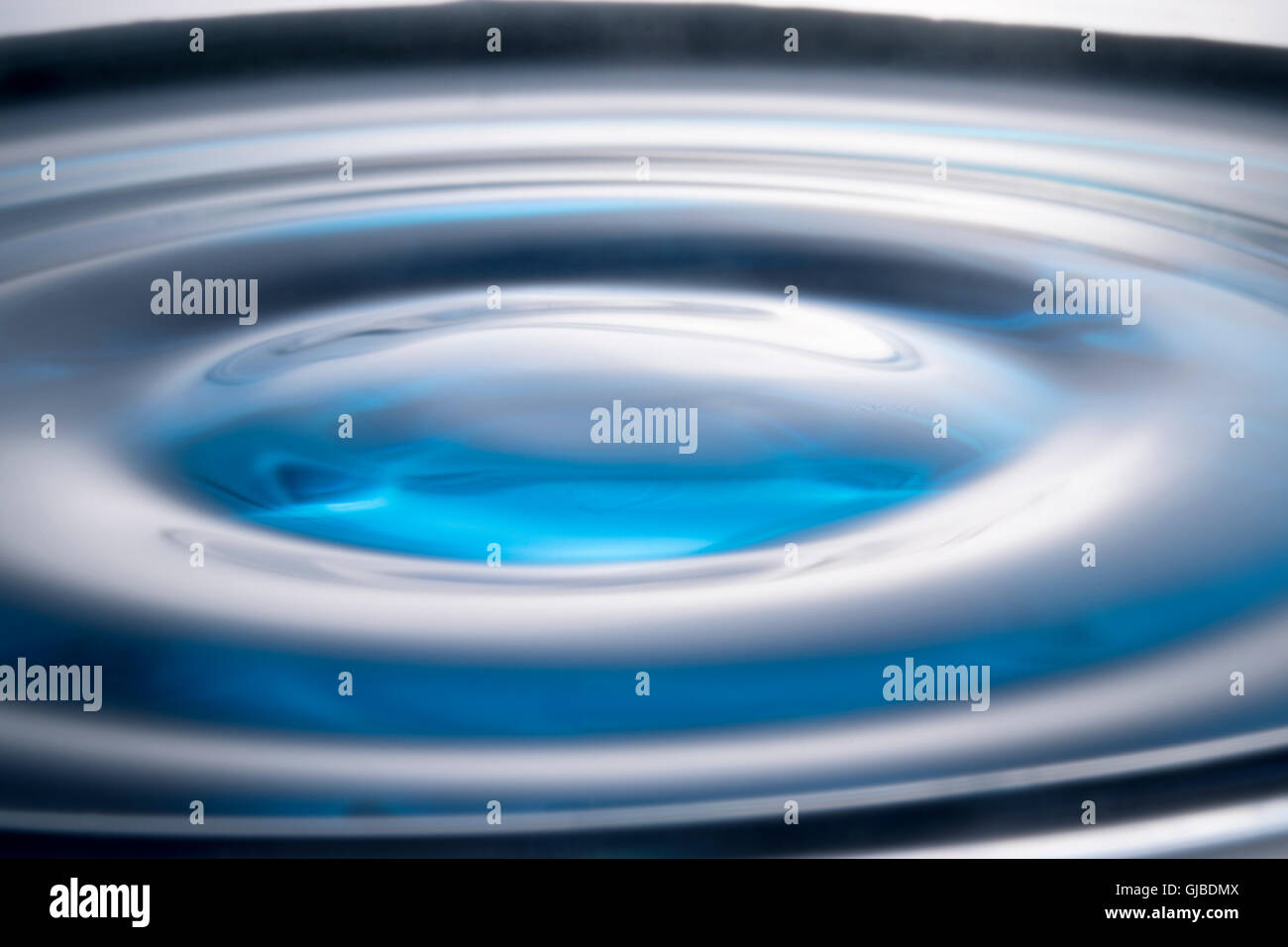 water droplet and ripple - Stock Image
