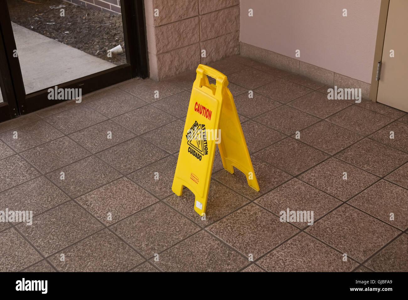 Caution, Slippery Floor, Slippery When Wet, folding warning sign - Stock Image