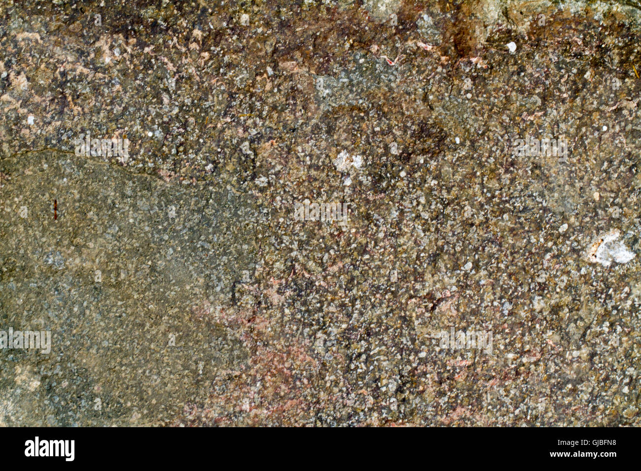 A grungy rock surface texture - Stock Image