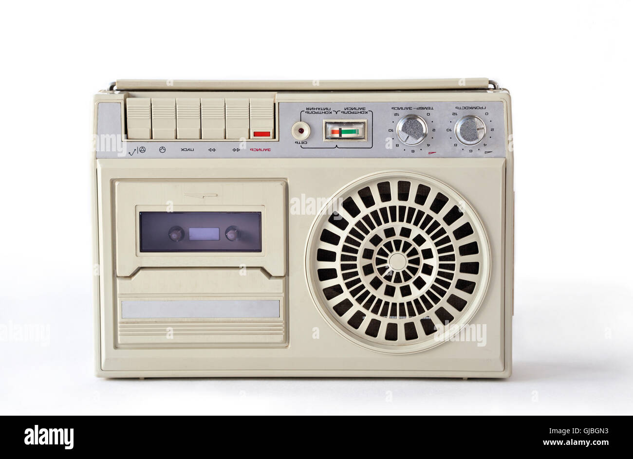 Old cassette tape player and recorder from USSR on white background - Stock Image
