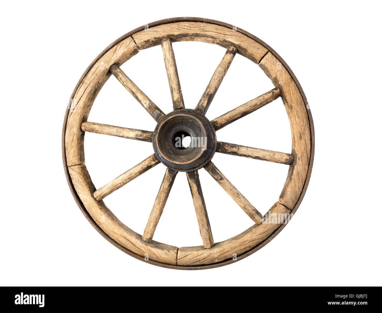 Old wooden wagon wheel isolated on white background - Stock Image