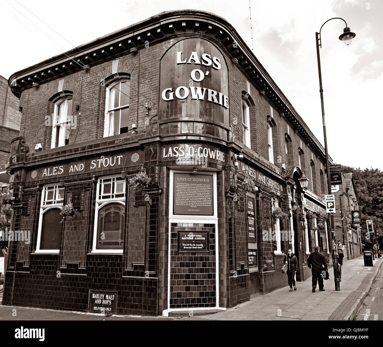 Lass O Gowrie pub, 36 Charles St, Manchester, North West England, UK,  M1 7DB in Sepia Black & White - Stock Image