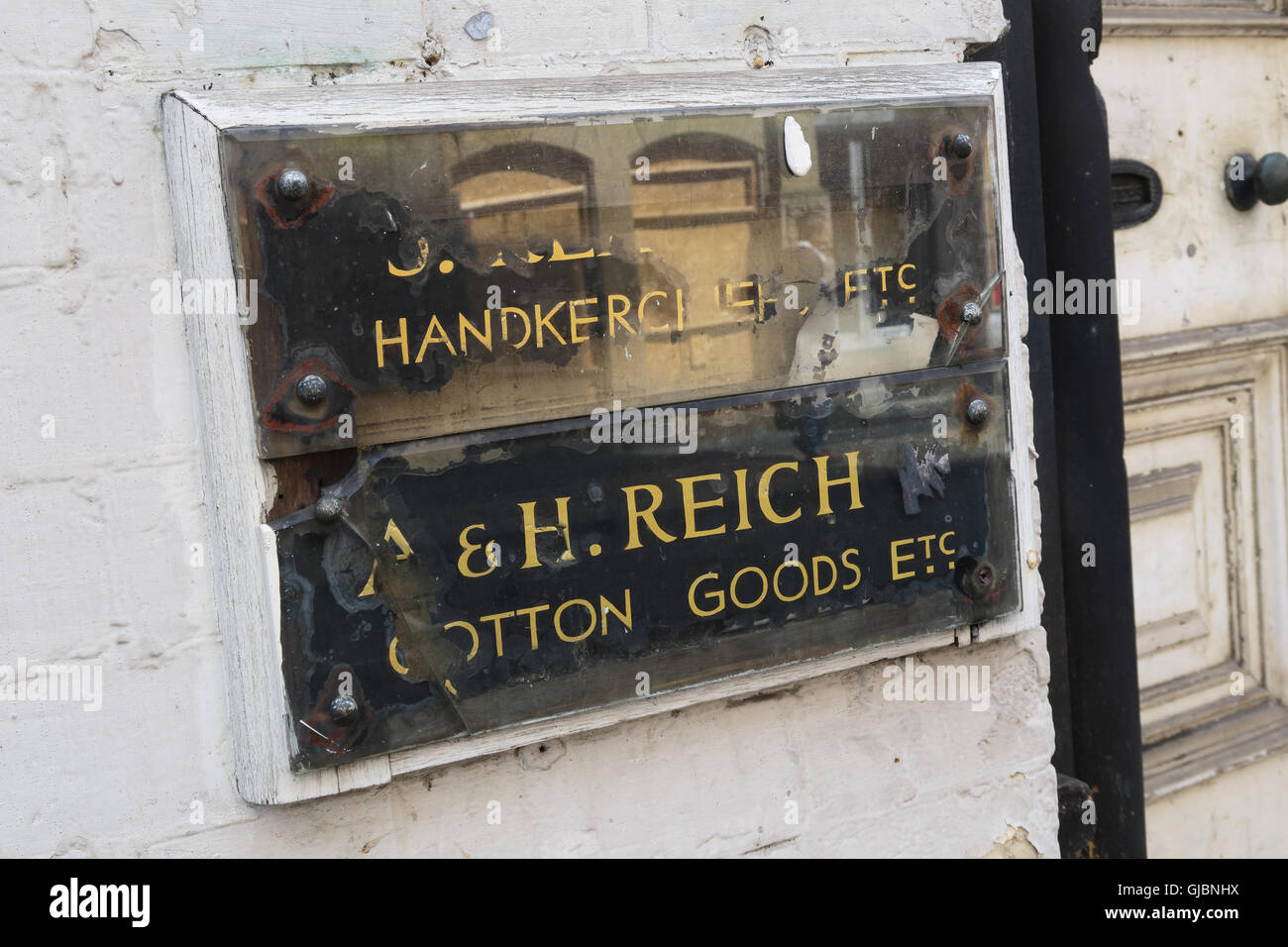 A & H Reich, Cotton Goods etc, Handkerchiefs etc, brass company plaque, Manchester Cotton Goods, City Centre, - Stock Image