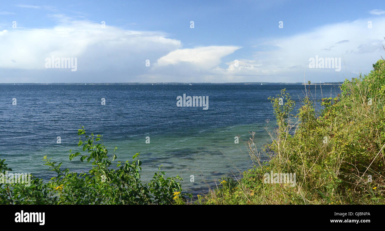 A cumulonimbus cloud with its anvil shape tries to establish on a warm autumn day, but fails. - Stock Image