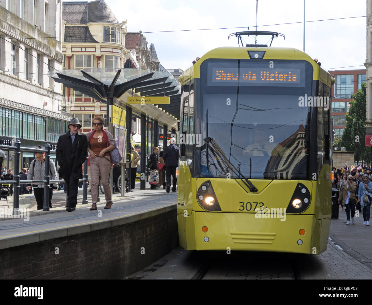 Manchester Yellow Metrolink Tram Light Railway Shaw via Victoria, in Market Street, City Centre, Greater Manchester, - Stock Image
