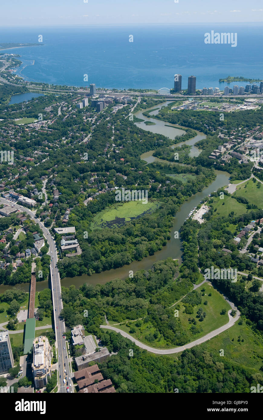 The lower reaches of Toronto's Humber River, with Lake Ontario visible in the background. Shot from above Bloor - Stock Image