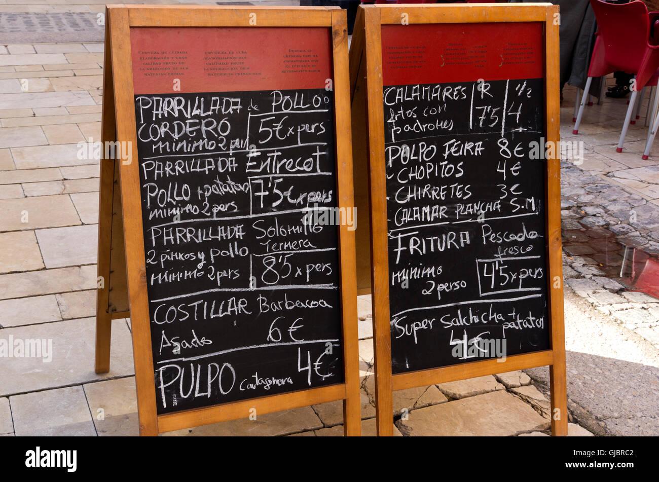 Two sandwich boards with menus written in chalk on blackboards. - Stock Image