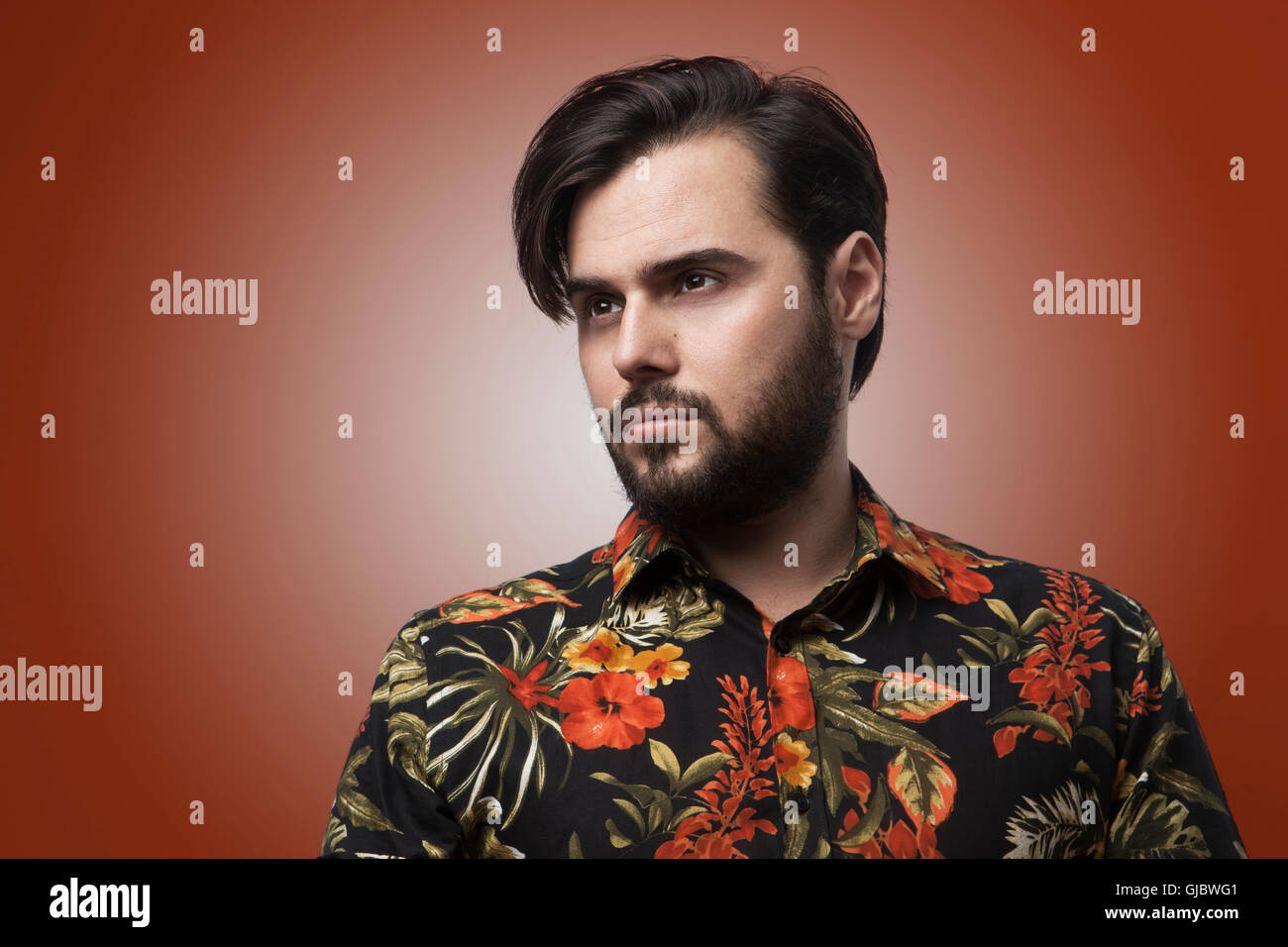 Portrait Handsome Bearded Man Wearing Stylish Color Shirt.Beauty,Lifestyle,People Concept Photo.Adult Serious Hipster - Stock Image