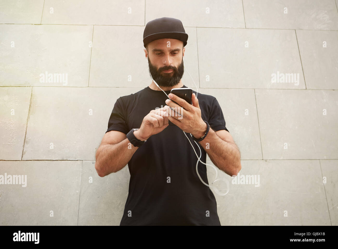 Bearded Muscular Man Wearing Black Tshirt Blank Snapback Cap Summer Time.Young Men Standing Opposite Empty Gray - Stock Image