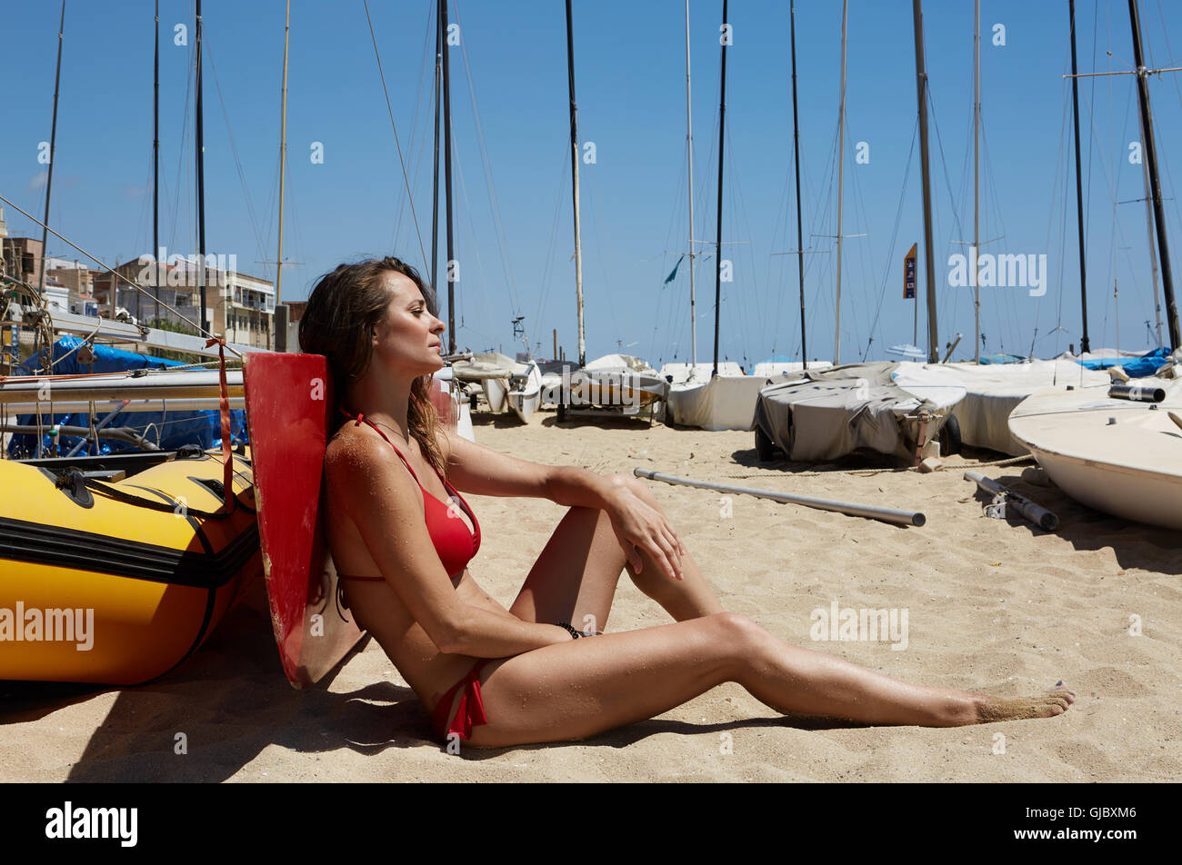 Photo Young Girl Making Chill Time Beach.Fitness Active Woman Spending Relax After Yaht Session Open Sea.Summer - Stock Image