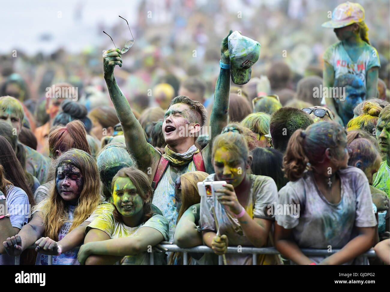 Vladivostok, Russia. 13th Aug, 2016. Young people covered in coloured powder during the Holi Festival of Colours - Stock Image
