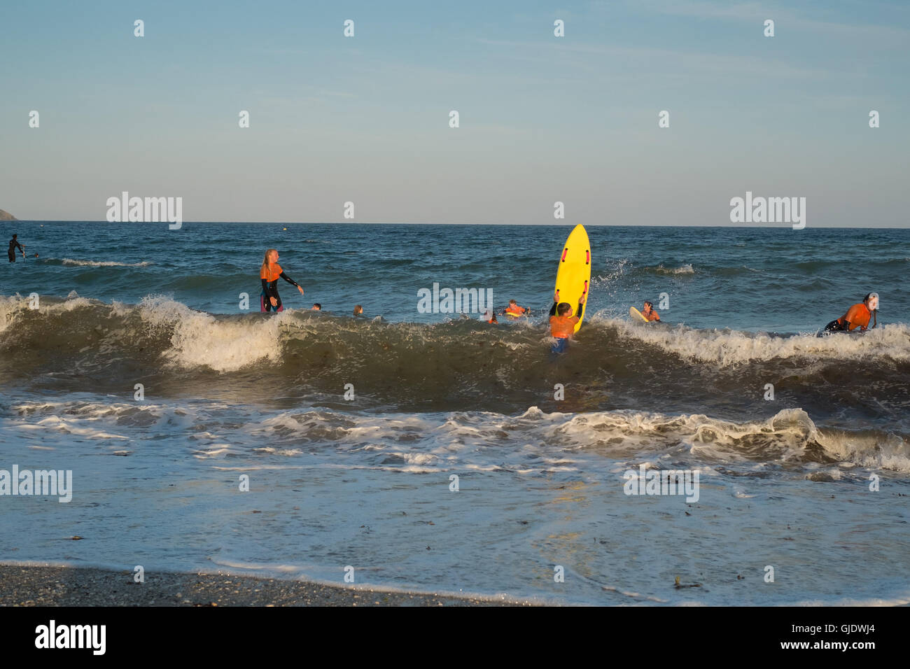 Falmouth, Cornwall, UK. 15th August, 2016. UK Weather: Surfers enjoying late evening surf at Gyllyngvase beach, - Stock Image
