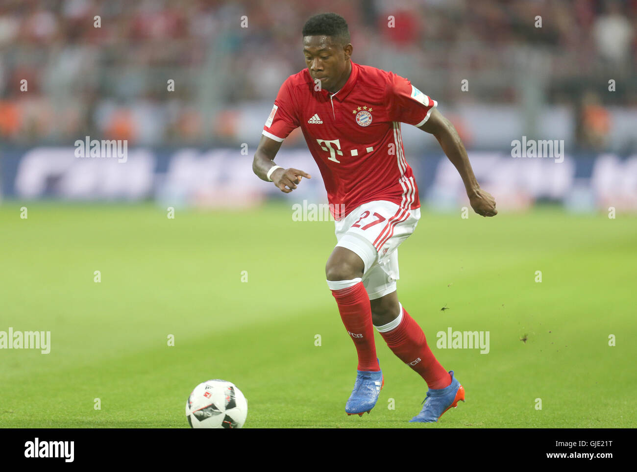 Munich's David Alaba in action during the DFL Supercup soccer match between Borussia Dortmund and Bayern Munich - Stock Image