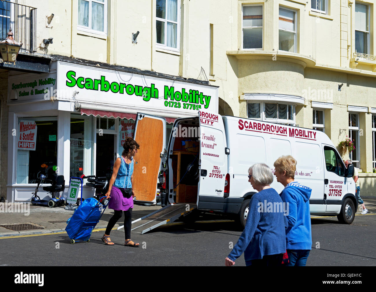Delivery van outside shop, Scarborough Mobility, selling mobility scooters, Scarborough, North Yorkshire, England - Stock Image