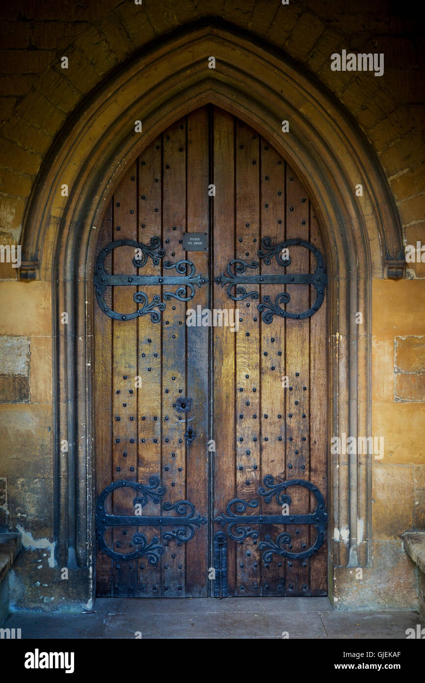 Wooden door entry to Saint Edwards Parish Church, Stow-on-the-Wold, Gloucestershire, England - Stock Image