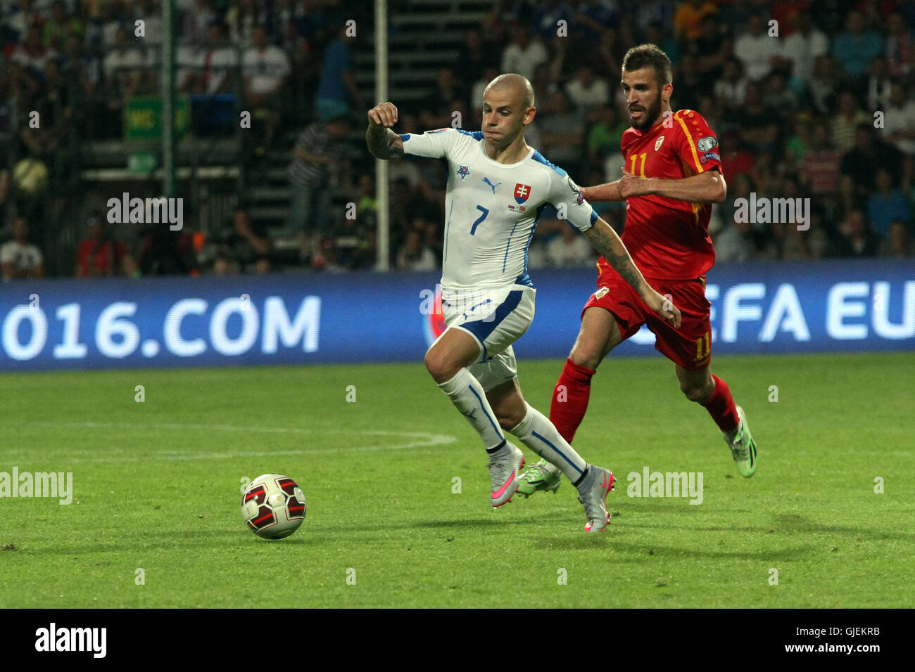 Vladimir Weiss (7) with the ball, behind him Feran Hasani (11) during the EURO 2016 qualifier Slovakia vs Macedonia - Stock Image