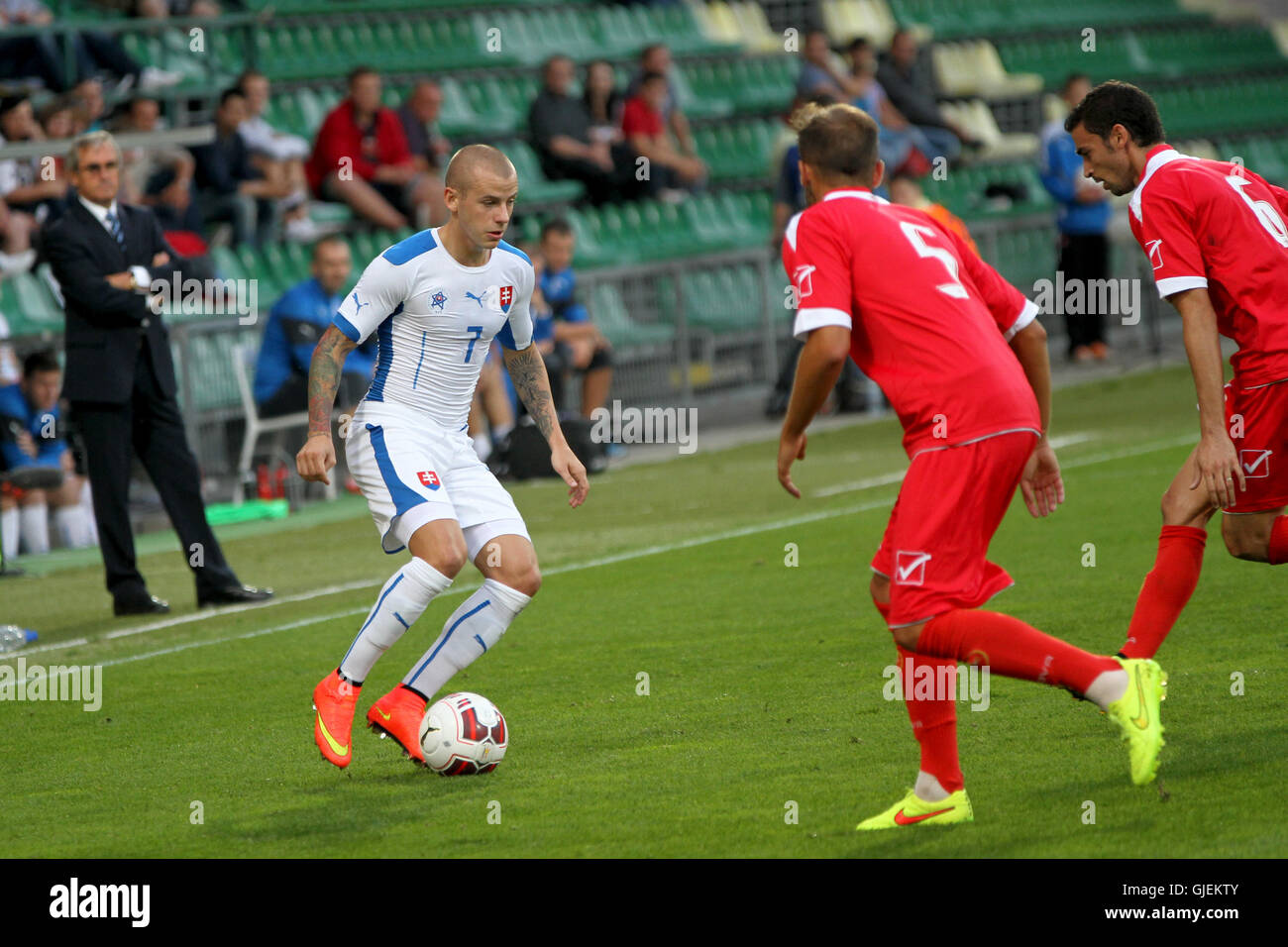 Slovakia's Vladimir Weiss (L) in action with Malta defenders during the friendly football match Slovakia vs Malta - Stock Image
