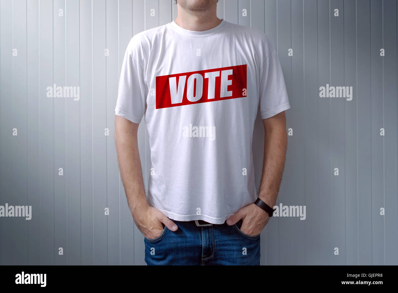 Man wearing t-shirt with Vote label printed on chest, express attitude and opinion on political elections Stock Photo