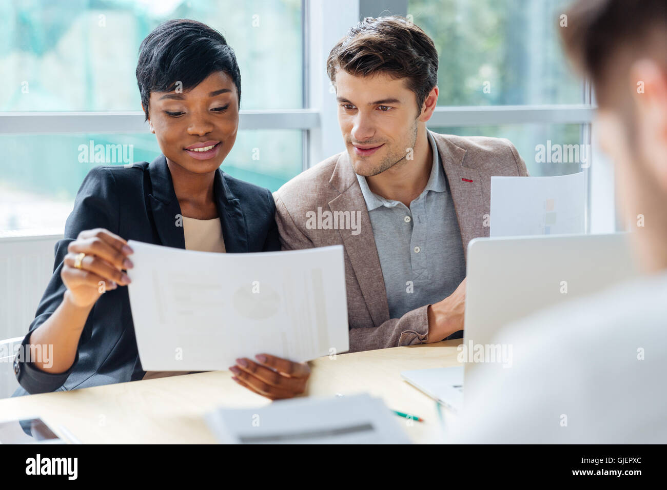 Creative group of young people brainstorming on meeting in office - Stock Image
