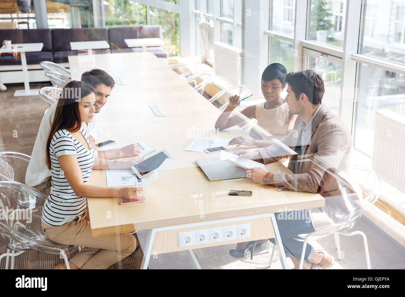 Multiethnic group of young business people on the meeting in conference room - Stock Image