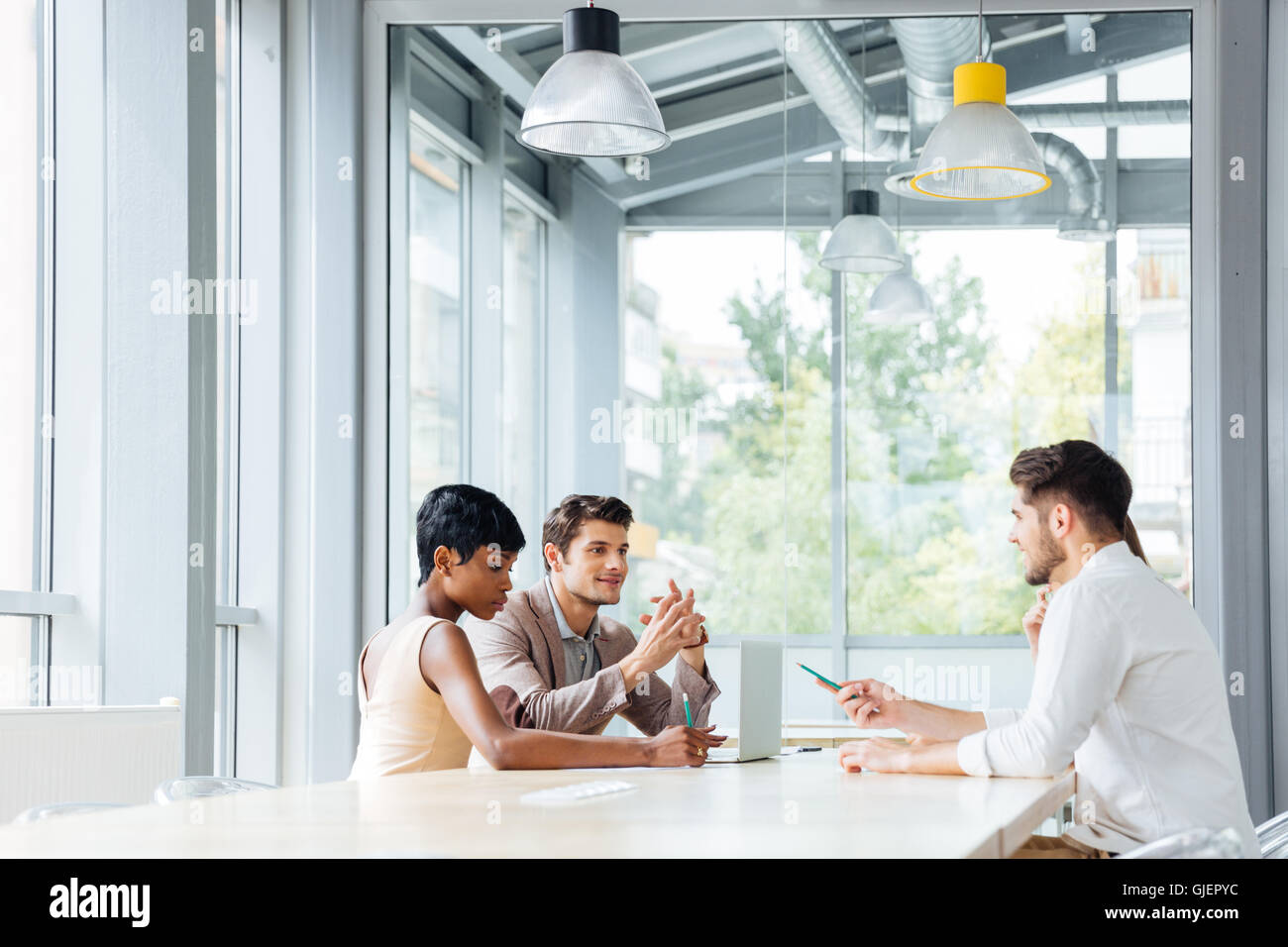 Group of young businesspeople working and brainstorming on meeting in office - Stock Image