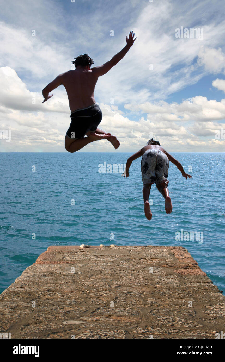 Man Jumping Off Bridge Ocean Stock Photos & Man Jumping Off Bridge