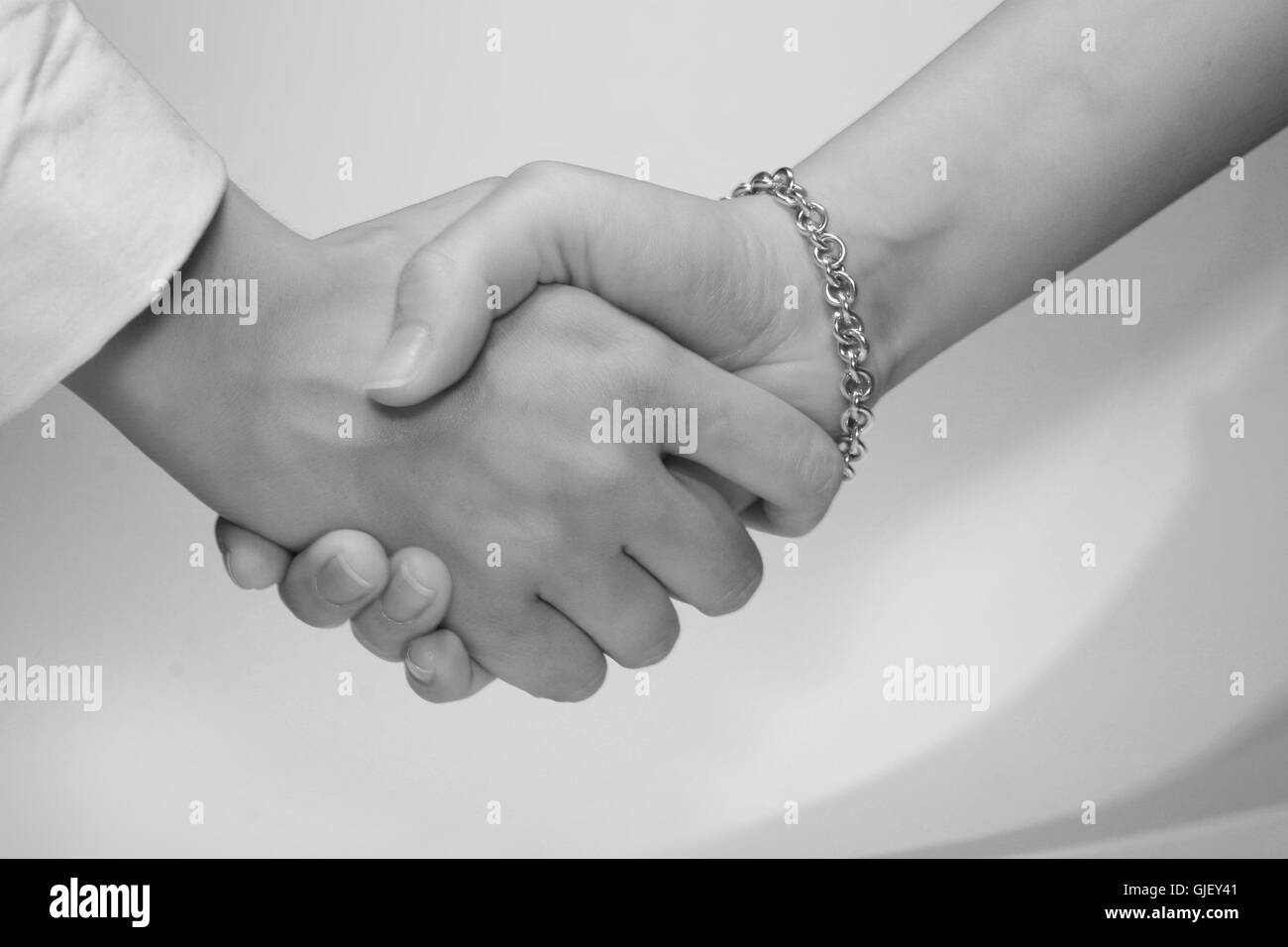 woman handshake - Stock Image