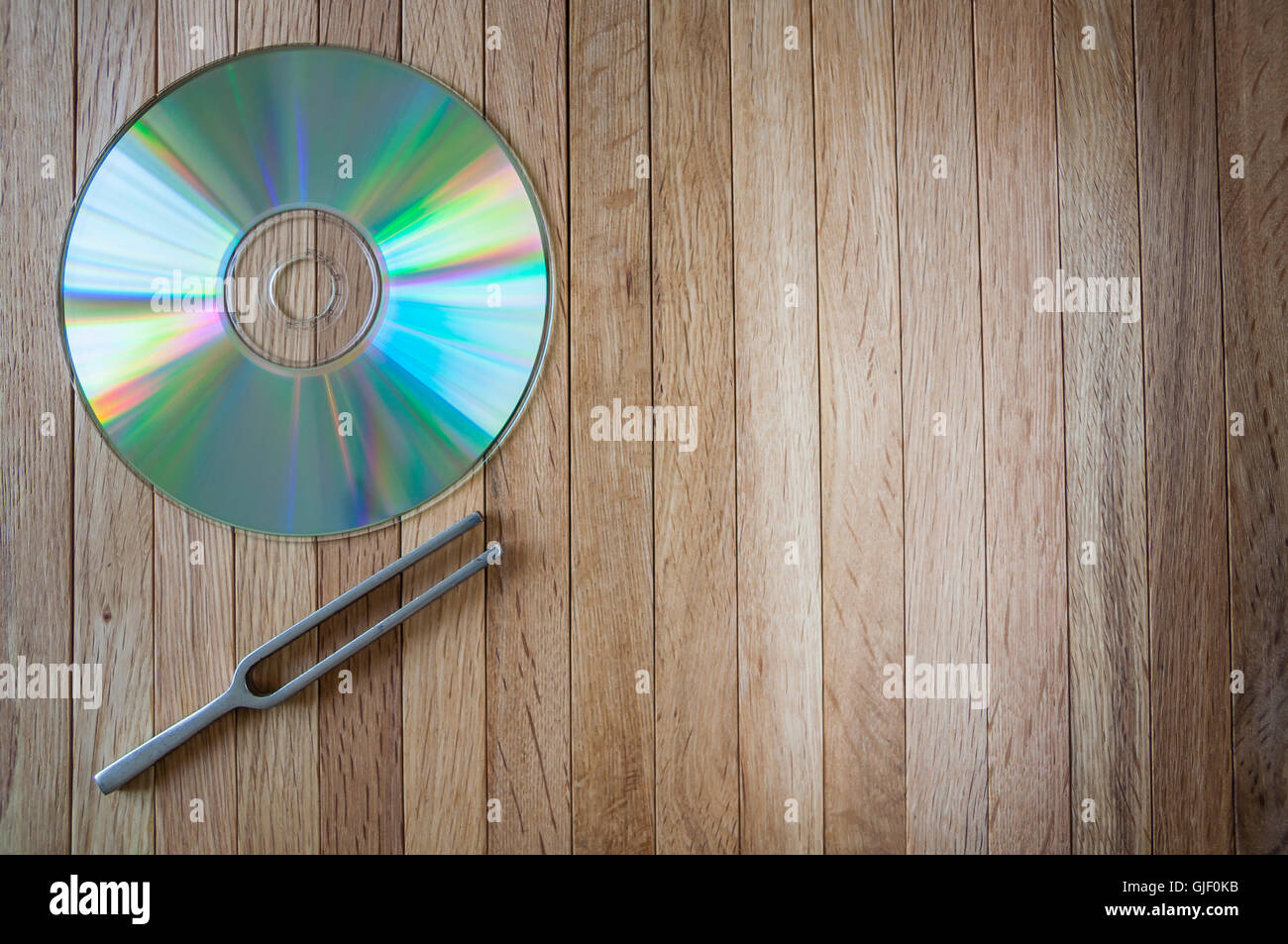 Compact Disc and Tuning Fork - Stock Image
