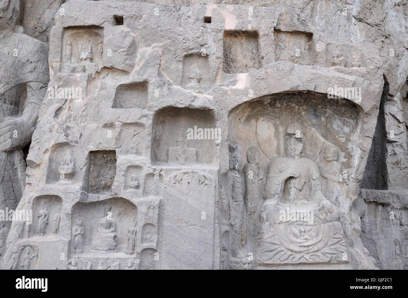 Ancient Buddha carvings and caves with longmen grottoes in Luoyang China in Henan Province. - Stock Image