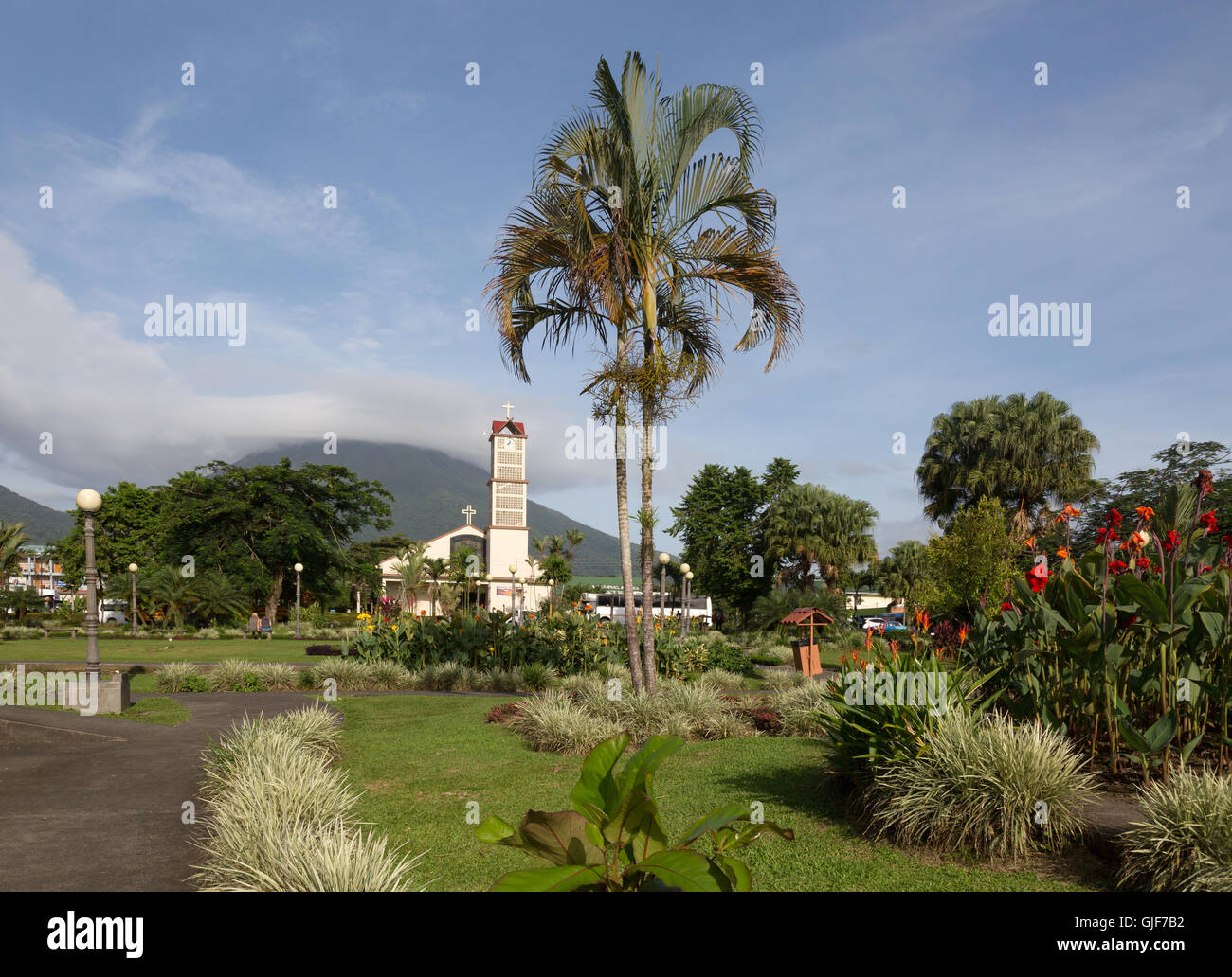 The church and Arenal Volcano, La Fortuna town, Alajuela province Costa Rica - Stock Image